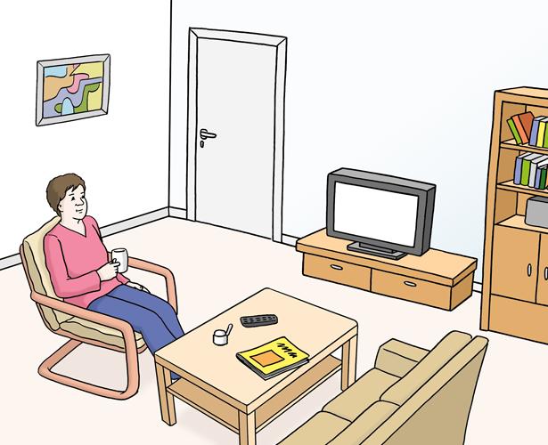 Frau sitzt in ihrem Wohnzimmer
